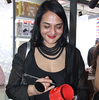 Designer Poonam Bhagat Signing Typhoo Tea Mug at her after show party at Typhoo Tea Bar at Amazon India Fashion Week 2015