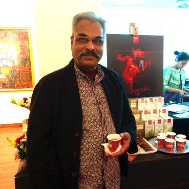 Artist Amitava Das savours Typhoo Green Tea at Aakriti Art Gallery.