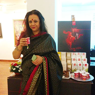 Art curator Ina Puri relishing Typhoo Tea at Aakriti Art Gallery.